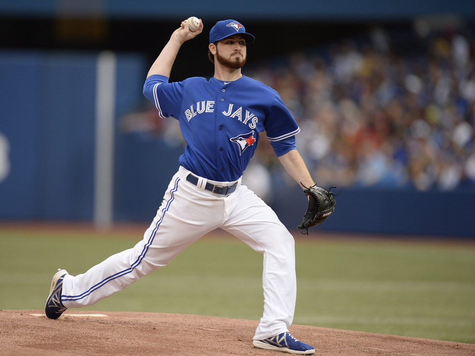 Photo - Toronto Blue Jays starter Drew Hutchinson pitches to the St. Louis Cardinals during a baseball game in Toronto, Sunday, June 8, 2014. (AP Photo/The Canadian Press, Frank Gunn)