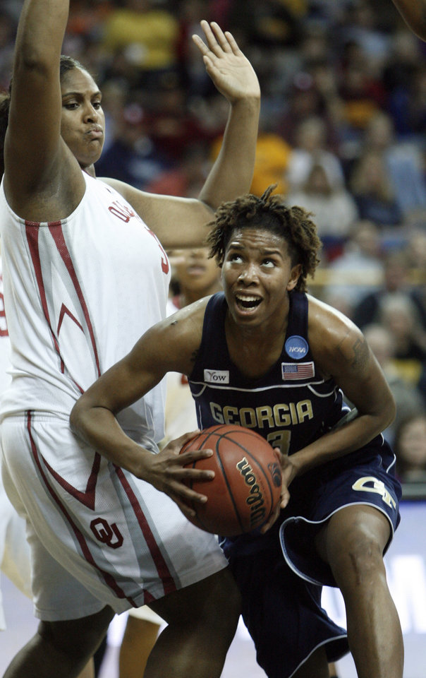 Photo - Deja Foster (23) drives past Courtney Paris in the first half as the University of Oklahoma (OU) plays Georgia Tech in round two of the 2009 NCAA Division I Women's Basketball Tournament at Carver-Hawkeye Arena at the University of Iowa in Iowa City, IA on Tuesday, March 24, 2009. 