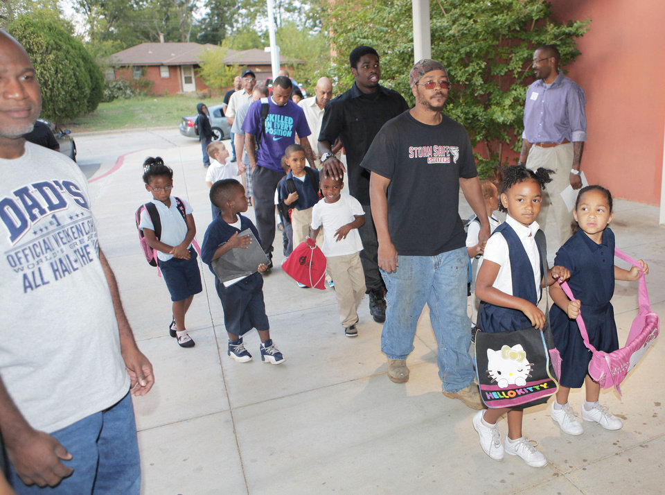 Dads drop off their children Friday at Martin Luther King Elementary School as part of Take Your Child to School Day. Photo By David McDaniel, The Oklahoman