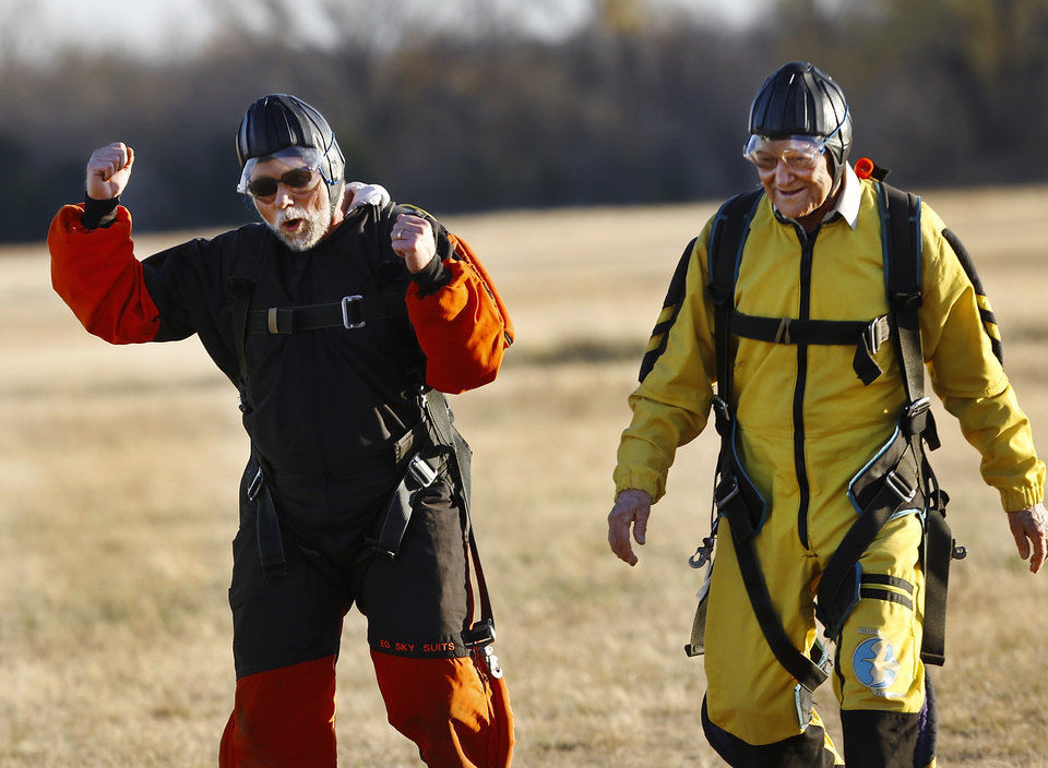 Steve Crawford, left, celebrates with his dad, Warren, after the pair landed safely less than one minute apart.  Warren Crawford, Oklahoma City, a 91 year-old WWII veteran, made his first skydive Saturday afternoon, Nov. 17, 2012, at Cushing Regional Airport. Crawford served as a bombardier during the war, but had never parachuted from a plane. He said this has been a dream of his for most of his life, but had promised his wife he wouldn't do it until after she died. Crawford's two sons, Steve and Bud,  joined their father on the skydiving adventure.The elder Crawford performed a tandem jump with Andy Beck, an instructor at Skydive Oklahoma, which gives lessons and provides an airplane service for skydiving enthusiasts.    Photo by Jim Beckel, The Oklahoman