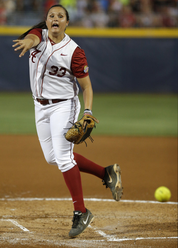 Photo - Alabama's Jaclyn Traina pitches during a Women's College World Series game between at ASA Hall of Fame Stadium in Oklahoma City Thursday, May 29, 2014. Photo by Bryan Terry, The Oklahoman