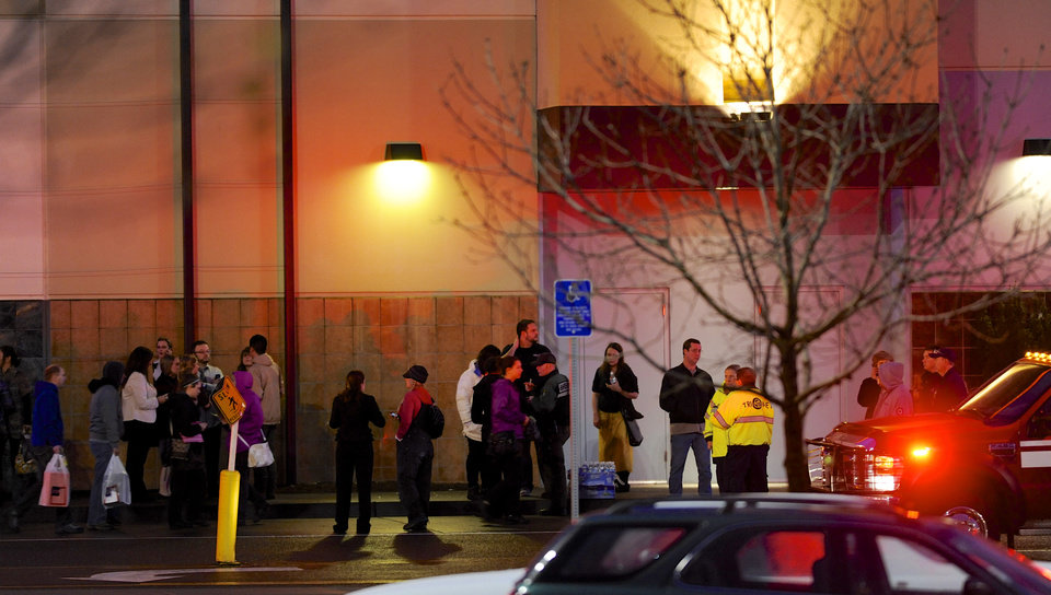 Photo - CORRECTS LOCATION OF MALL - Shoppers wait to be evacuated outside the scene of a multiple shooting at Clackamas Town Center Mall in Portland, Ore., Tuesday Dec. 11, 2012. A gunman is dead after opening fire in the Portland, Ore., area shopping mall Tuesday, killing two people and wounding another, sheriff's deputies said. (AP Photo/Greg Wahl-Stephens)