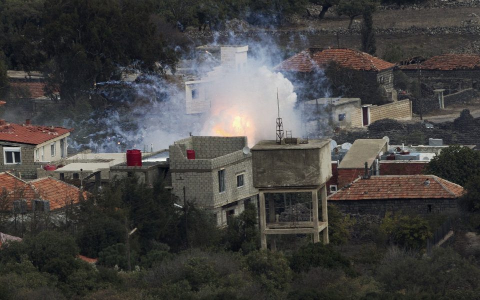 An explosion after shells fired by the Syrian army hit the Syrian village of Bariqa, Monday, Nov. 12, 2012. The Israeli military says