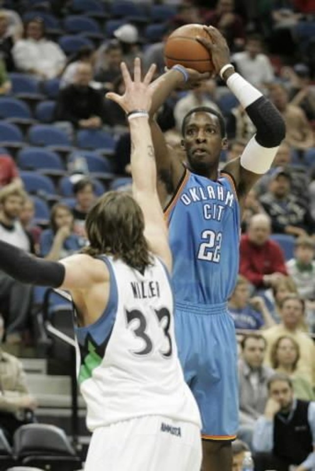 Oklahoma City Thunder forward  Jeff  Green (22) shoots over Minnesota Timberwolves Mike Miller (33) during the first half in an NBA basketball game, Sunday, March 22, 2009 in Minneapolis.  Green had 17 points in the game as the Thunder won 97-90. (AP Photo/Paul Battaglia)