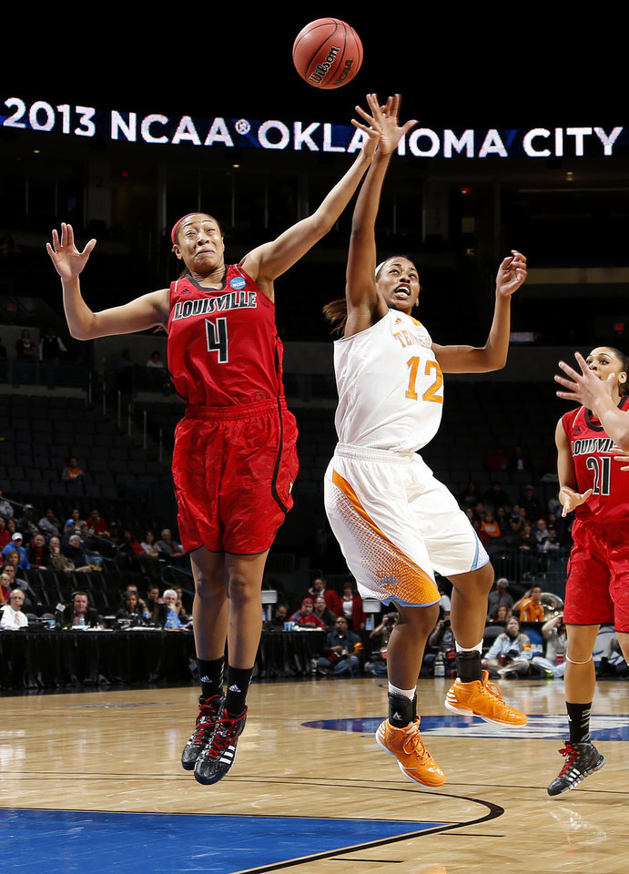 Louisville's Antonita Slaughter (4) and Tennessee's Bashaara Graves (12)  go for the ball during the Oklahoma City Regional for the NCAA women's college basketball tournament  between the University of Tennessee and Louisville at Chesapeake Energy Arena in Oklahoma City, Tuesday, April 2, 2013. Photo by Bryan Terry, The Oklahoman