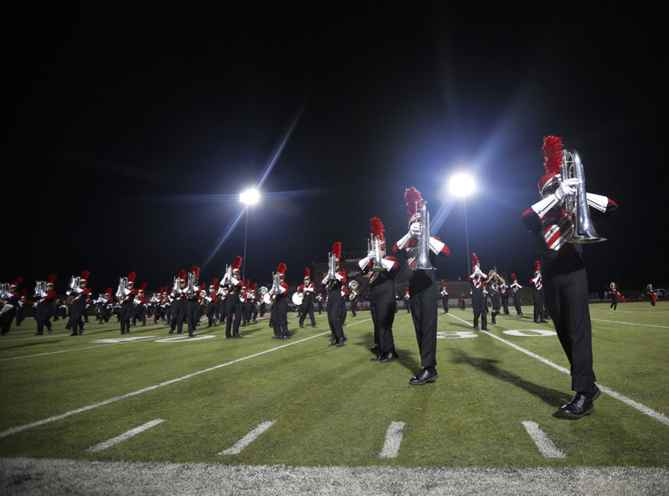 Photo - The Mustang High School Marching Band performs at halftime during a high school football game between Mustang and Stillwater in Mustang, Okla., Friday, Sept. 14, 2012.  Photo by Garett Fisbeck, The Oklahoman