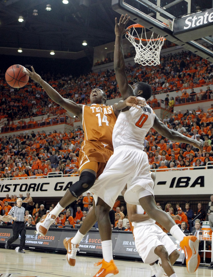 Oklahoma State's Jean-Paul Olukemi (0)Êblocks Texas' J'Covan Brown's shot during the basketball game between Oklahoma State and Texas, Wednesday, Jan. 26, 2011, at Gallagher-Iba Arena in Stillwater, Okla. Photo by Sarah Phipps, The Oklahoman ORG XMIT: KOD