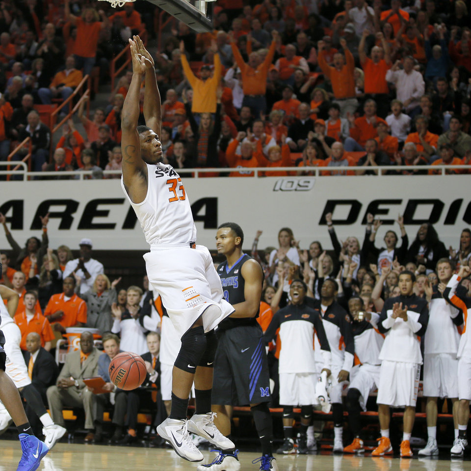 Photo - Oklahoma State's Marcus Smart (33) celebrates after a dunk during an NCAA college basketball game between Oklahoma State and Memphis at Gallagher-Iba Arena in Stillwater, Okla., Tuesday, Nov. 19, 2013. Photo by Bryan Terry, The Oklahoman