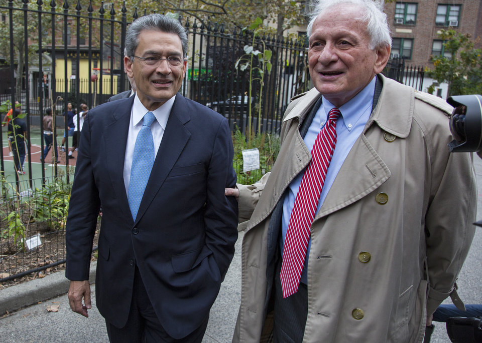 Photo -   Former Goldman Sachs and Procter & Gamble Co. board member Rajat Gupta, left, arrives outside federal court in New York Wednesday, Oct. 24, 2012. Gupta is to be sentenced after being found guilty insider trading by passing secrets between March 2007 and January 2009 to a billionaire hedge fund founder who used the information to make millions of dollars. At right is Gupta's attorney Gary Naftalis. (AP Photo/Craig Ruttle)