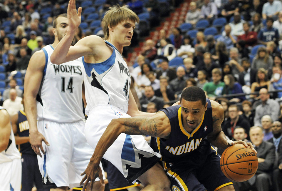 Indiana Pacers' George Hill, right, assumes a low profile as he drives around Minnesota Timberwolves' Andrei Kirilenko of Russia, during the first half of an NBA basketball game Friday, Nov. 9, 2012, in Minneapolis. (AP Photo/Jim Mone)