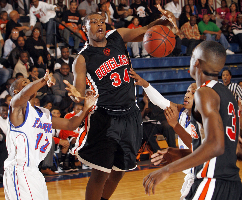 Delondre Williams (34) of Douglass tries to keep control of the ball during a boys high school basketball game between Douglass and Millwood at the Millwood Field House in Oklahoma City, Friday, Jan. 13, 2012. Photo by Nate Billings, The Oklahoman