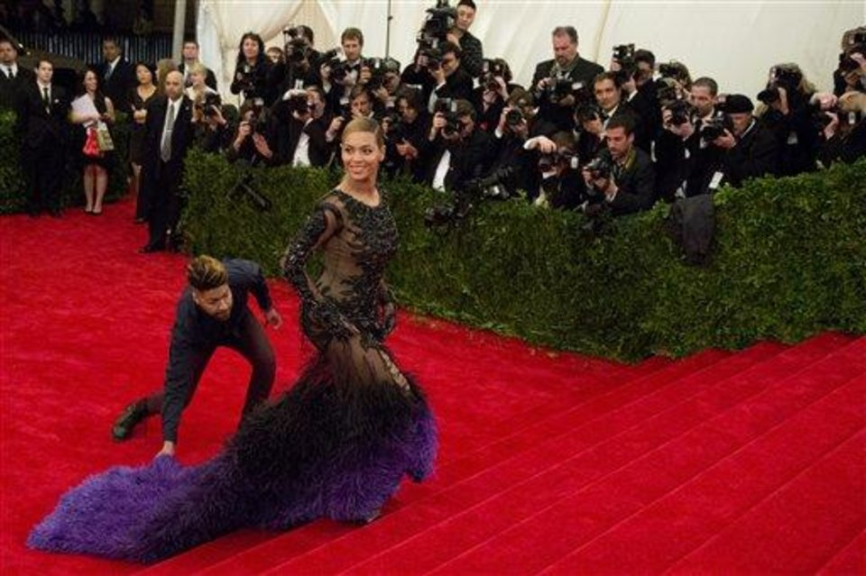 Beyonce arrives at the Metropolitan Museum of Art Costume Institute gala benefit, celebrating Elsa Schiaparelli and Miuccia Prada, Monday, May 7, 2012 in New York. (AP Photo/Charles Sykes)