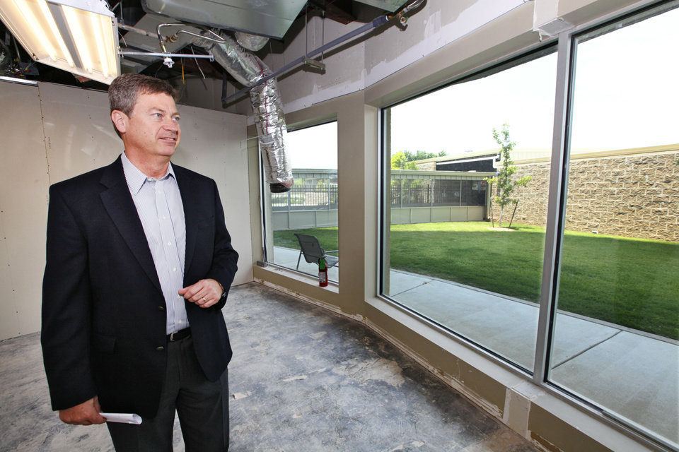 Jeff Smith, president and CEO of PrimeSource Mortgage, looks at renovations of space it is expand into at Founders Tower. The company moved here from Roswell, N.M., in August 2012. <strong>David McDaniel - The Oklahoman</strong>