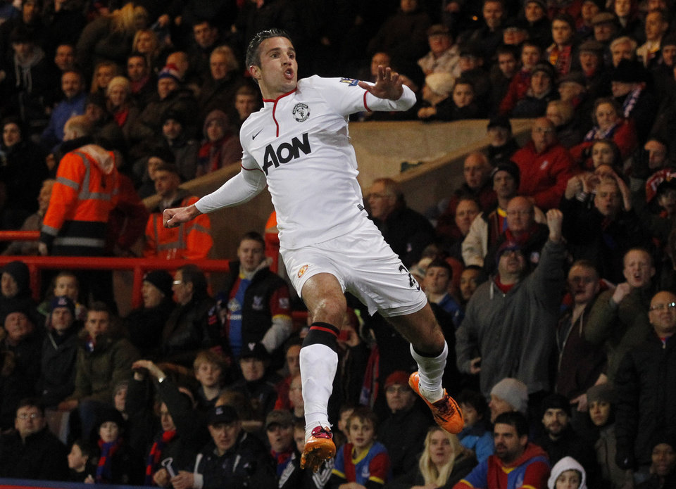 Photo - Manchester United's Robin Van Persie celebrates his penalty goal against Crystal Palace during their English Premier League soccer match at Selhurst Park, London, Saturday, Feb. 22, 2014. (AP Photo/Sang Tan)