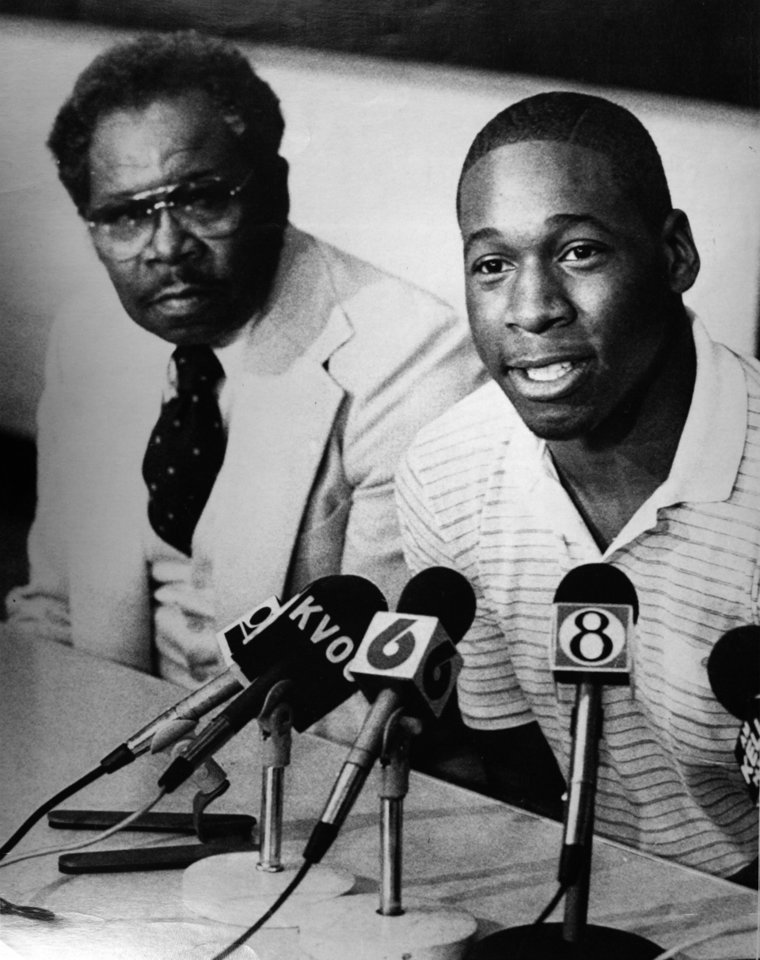 Former OU basketball player Wayman Tisdale. With his father, The Rev. Louis Tisdale at his side, Wayman Tisdale (right) announces his decision Tuesday in Tulsa to side with the Oklahoma Sooners. SECOND CUTLINE - Oklahoma's Wayman Tisdale becomes the first freshman ever named to the U.S. Basketball Writers Association All-America team and Virginia's Ralph Sampson in chosen to the squad for the third time. Tisdale, 6-9, 240 pounds, averages 26 points and 11 rebounds and leads the Big Eight Conference in both. (AP LaserPhoto) Photo taken unknown, Photo published 4/14/1982, 3/8/1983, 4/10/1983 in The Daily Oklahoman. ORG XMIT: KOD