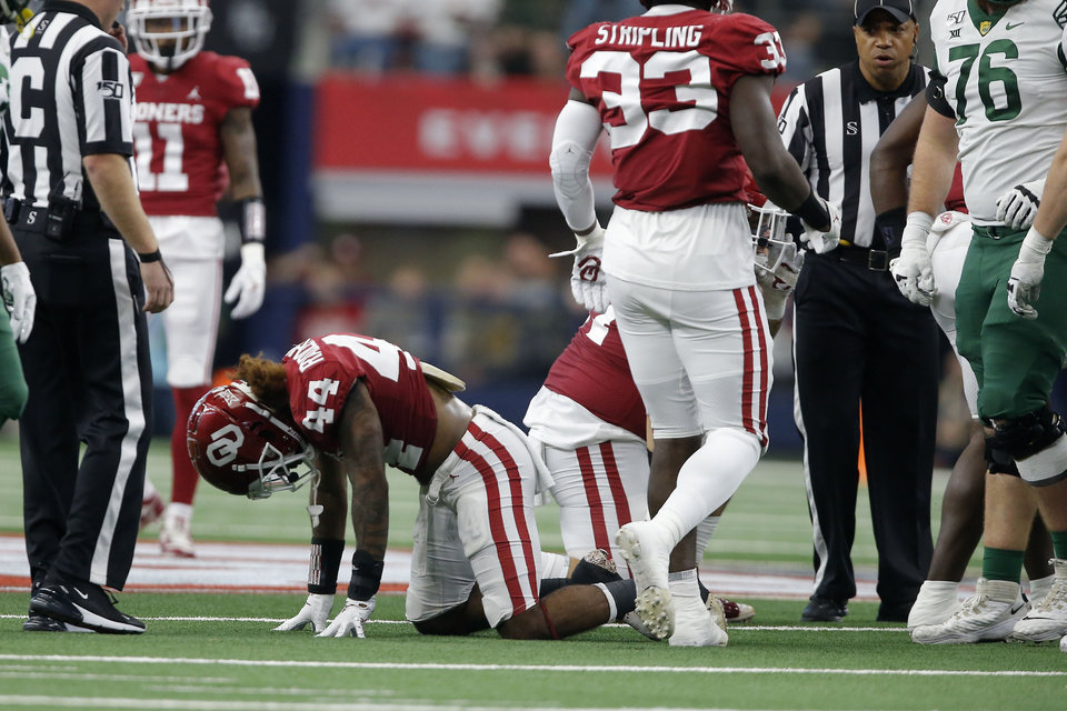 Photo - Oklahoma's Brendan Radley-Hiles (44) takes a moment to get up after a play during the Big 12 Championship Game between the University of Oklahoma Sooners (OU) and the Baylor University Bears at AT&T Stadium in Arlington, Texas, Saturday, Dec. 7, 2019. Oklahoma won 30-23. [Bryan Terry/The Oklahoman]