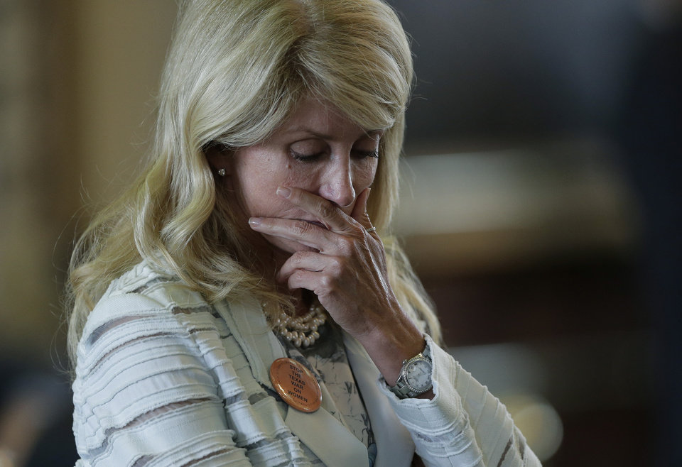 Photo - Sen. Wendy Davis, D-Fort Worth, reacts after she was called for a rules violation during her filibusters of an abortion bill, Tuesday, June 25, 2013, in Austin, Texas. Davis was given a second warning for breaking filibuster rules. (AP Photo/Eric Gay)