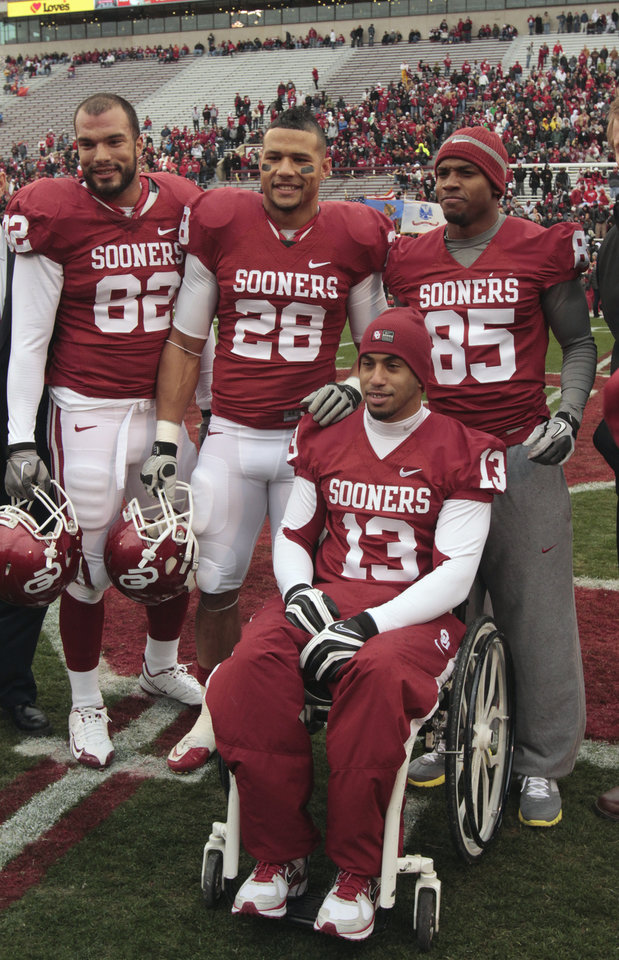 Photo - Oklahoma's James Hanna (82), Oklahoma's Travis Lewis (28), Oklahoma's Ryan Broyles (85) and Corey Wilson (13) receive the Don Key award before a college football game between the University of Oklahoma Sooners (OU) and the Iowa State University Cyclones (ISU) at Gaylord Family-Oklahoma Memorial Stadium in Norman, Okla., Saturday, Nov. 26, 2011. Photo by Steve Sinsey, The Oklahoman