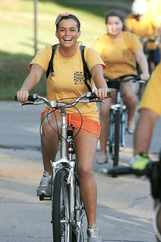Photo - Edmond Memorial High School senior Madison Epps bikes to the school.  PHOTO BY PAUL HELLSTERN, THE OKLAHOMAN