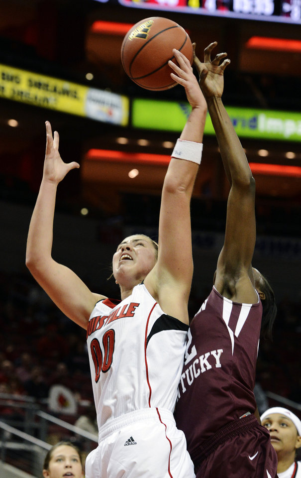 Photo -   Louisville's Sara Hammond, left, attempts to grab a rebound away from Eastern Kentucky's Jade Barber during the second half of their NCAA college basketball game, Wednesday, Nov. 28, 2012, in Louisville, Ky. Louisville won 76-42. (AP Photo/Timothy D. Easley)