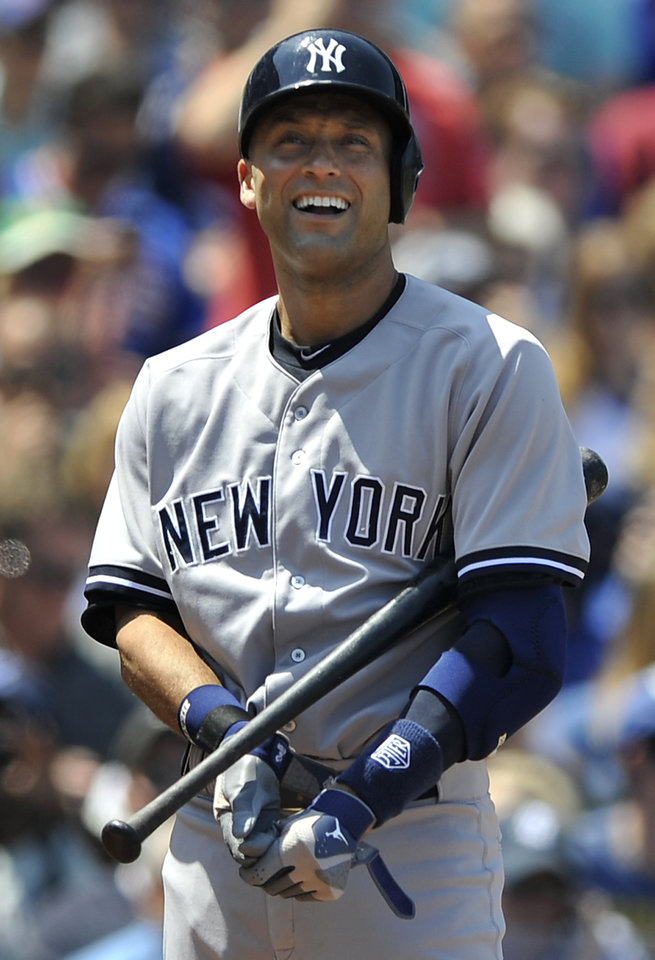Photo - New York Yankees' Derek Jeter reacts to striking out during the third inning of a baseball game against the Chicago Cubs in Chicago, May 21, 2014. (AP Photo/Paul Beaty)