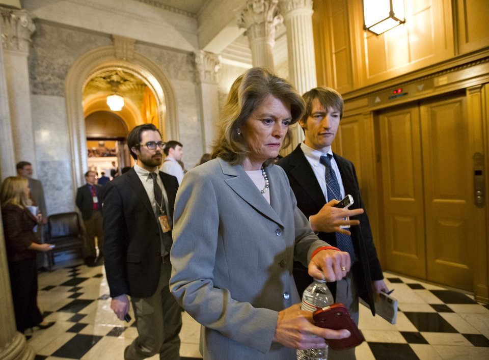 Photo - Sen. Lisa Murkowski, R-Alaska, leaves the Senate chamber as Senate Republicans stalled the nomination of former GOP senator Chuck Hagel as the nation's next defense secretary, at the Capitol in Washington, Thursday, Feb. 14, 2013. Murkowski was one of four Republicans who voted with Democrats to end the debate and proceed to a final vote.  (AP Photo/J. Scott Applewhite)