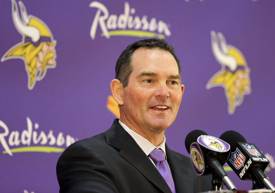 Photo - New Minnesota Vikings head coach Mike Zimmer answers a question during an NFL football media availability at Winter Park in Eden Prairie, Minn., Friday, Jan. 17, 2014. Zimmer is the ninth head coach in the Vikings' franchise history.(AP Photo/Ann Heisenfelt)