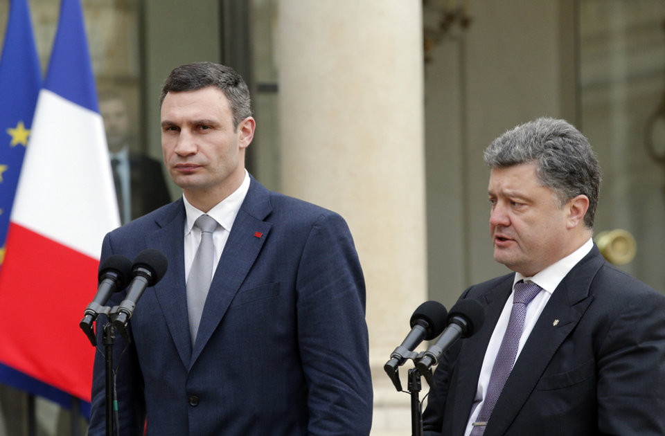 Vitali Klitschko, former heavyweight boxing champion and Ukrainian leader of UDAR party, left, and former Ukrainian foreign minister Petro Porochenko talk to reporters after a meeting with French president Francois Hollande, at the Elysee Palace, in Paris, Friday, March 7, 2014. The Ukrainian politicians discussed the current situation in Ukraine with the French President. (AP Photo/Christophe Ena)