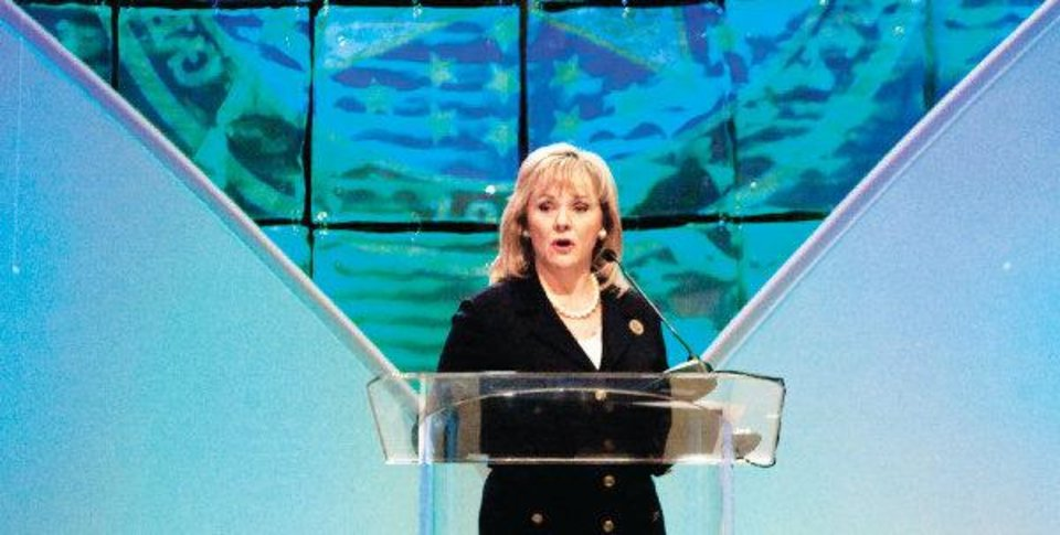 Photo - Gov. Mary Fallin discusses her plan to increase the availability of natural gas vehicles Wednesday during the 2011 Governor's Energy Conference at the Cox Convention Center. Photo by Steve Maupin, For The Oklahoman