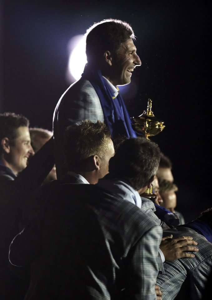 European team captain Jose Maria Olazabal is lifted by his players as they pose for pictures after winning the Ryder Cup PGA golf tournament Sunday, Sept. 30, 2012, at the Medinah Country Club in Medinah, Ill. (AP Photo/Charlie Riedel)  ORG XMIT: PGA265