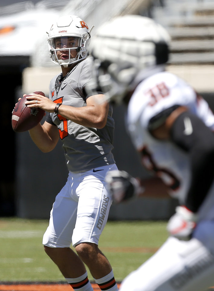 Photo -  Oklahoma State quarterback Spencer Sanders (3) looks to throw the ball as linebacker Philip Redwine-Bryant moves into coverage during Saturday's scrimmage. [Sarah Phipps/The Oklahoman]