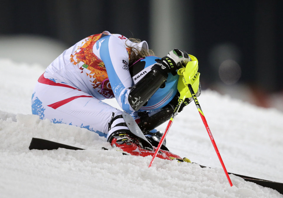 Photo - Austria's Bernadette Schild reacts after skiing out of the second run in the women's slalom at the Sochi 2014 Winter Olympics, Friday, Feb. 21, 2014, in Krasnaya Polyana, Russia.  (AP Photo/Charles Krupa)