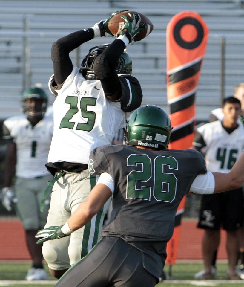 Photo -                    Edmond Santa Fe's Darren Williams, left, is part of a talented junior class.                    Photo by Steve Sisney, The Oklahoman