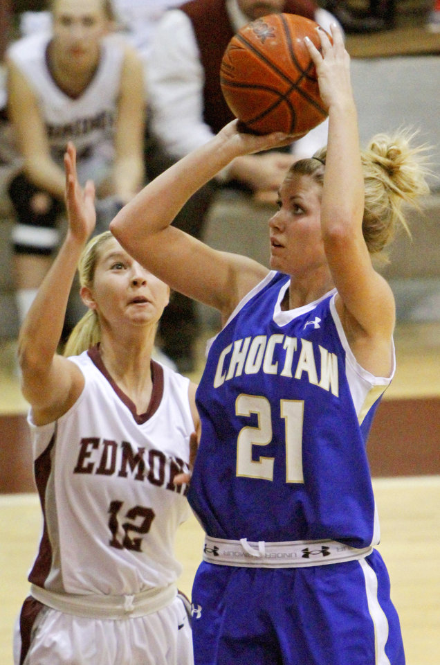 Choctaw's Abigail Sivard, right, shoots the ball beside Edmond Memorial's Sommer Peterson during the Class 6A girls basketball regional championship game at Edmond Memorial High School, Saturday, Feb. 25, 2012. Photo By Bryan Terry, The Oklahoman