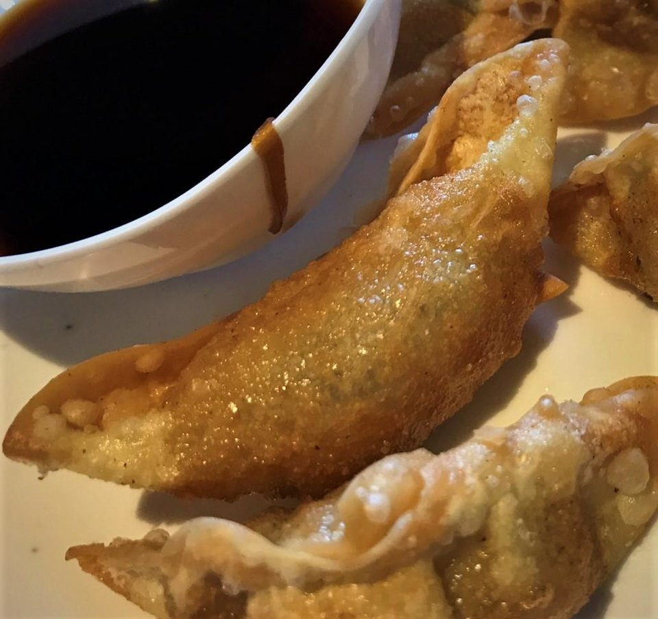 Photo - Fried dumplings from Taste of Korea in Oklahoma City. [Dave Cathey/The Oklahoman]