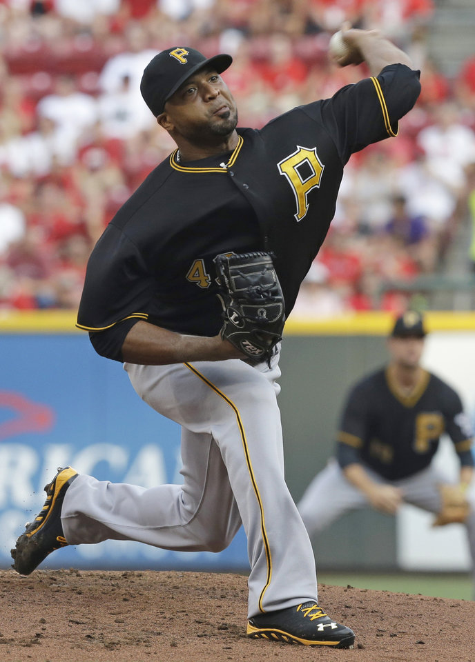 Photo - Pittsburgh Pirates starting pitcher Francisco Liriano throws against the Cincinnati Reds in the first inning of a baseball game, Friday, July 19, 2013, in Cincinnati. (AP Photo/Al Behrman)