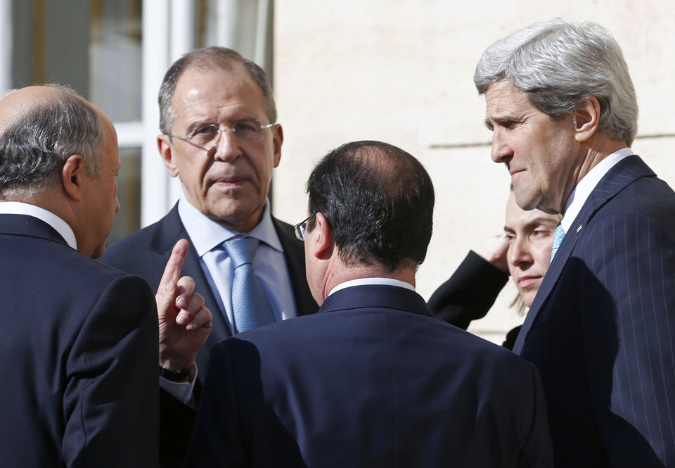 Photo - From left, French Foreign Minister Laurent Fabius, Russian Foreign Minister Sergey Lavrov, French President Francois Hollande, Italian Foreign Minister Federica Mogherini and U.S. Secretary of State John Kerry, talk together during a break of a meeting at the Elysee Palace in Paris, Wednesday, March 5, 2014. Top diplomats from the West and Russia trying to find an end to the crisis in Ukraine are gathering in Paris on Wednesday as tensions simmered over the Russian military takeover of the strategic Crimean Peninsula. (AP Photo/Alain Jocard, Pool)