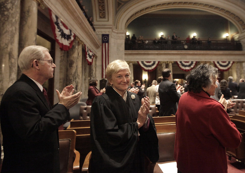 Members of the Wisconsin State Supreme Court, including Justice David Prosser, Jr., left, Justice Patience Roggensack, center, and Chief Justice Shirley Abrahamson, right, gather for Governor Scott Walker\'s state budget address at the Wisconsin State Capitol in Madison, Wis. Wednesday, February 20, 2013. (AP Photo/Wisconsin State Journal, John Hart)