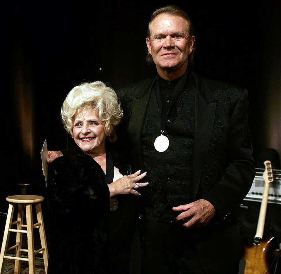 Photo - Brenda Lee congratulates Glen Campbell after he received is Country Music Hall of Fame medallion during a ceremony Sunday, May 7, 2006, in Nashville, Tenn.  (AP Photo/The Tennessean, John Partipilo)