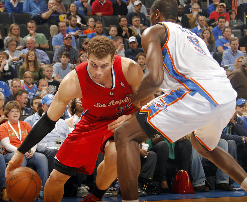 Photo - Los Angeles Clippers power forward Blake Griffin (32) drives on Oklahoma City Thunder power forward Serge Ibaka (9) during the NBA basketball game between the Oklahoma City Thunder and the Los Angeles Clippers at Chesapeake Energy Arena on Wednesday, March 21, 2012 in Oklahoma City, Okla.  Photo by Chris Landsberger, The Oklahoman