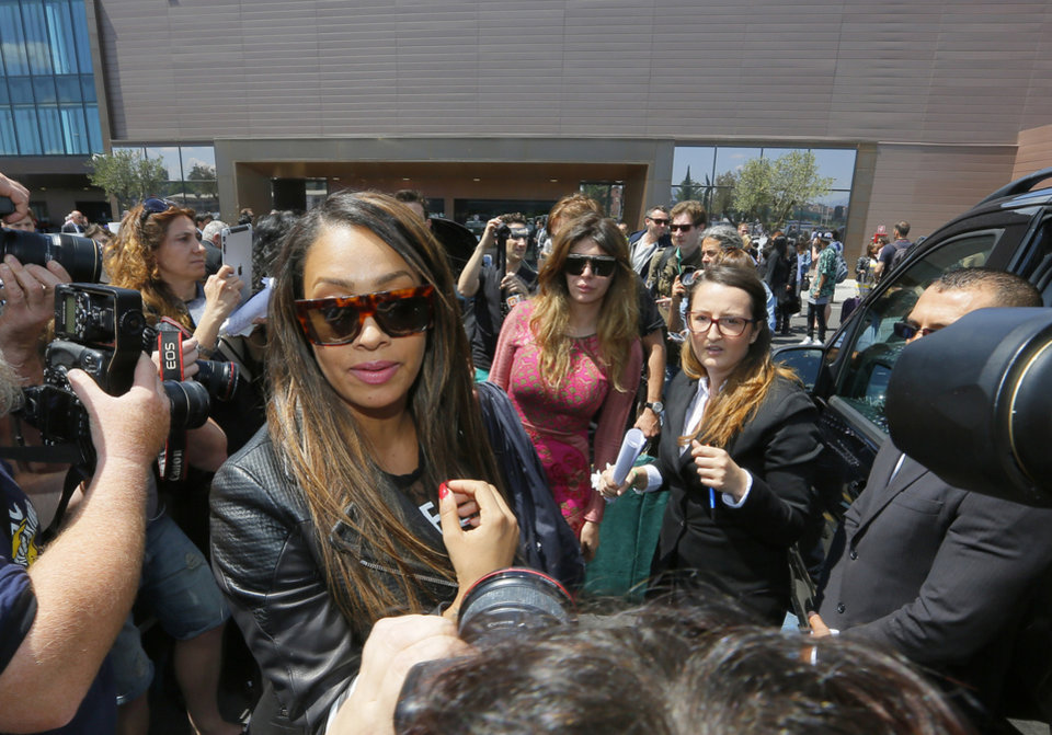 Photo - American television personality La La Anthony arrives in Florence, Italy, Saturday, May 24, 2014. Kim Kardashian and Kanye West will wed and host a reception at Florence's imposing 16th-century Belvedere Fort on May 24, according to a spokeswoman at the Florence mayor's office. The couple rented the fort, located next to Florence's famed Boboli Gardens, for 300,000 euros ($410,000) and a Protestant minister will preside over the ceremony. Belvedere Fort was built in 1590, believed using plans by Don Giovanni de' Medici. Located near the Arno River, it offers a panoramic view of Florence and the surrounding Tuscan hills. (AP Photo/Fabio Muzzi)