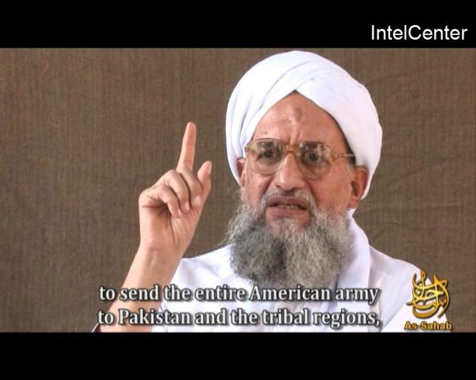 "FILE - In this file video frame grab image provided by IntelCenter, a private terrorism analysis company, and taken from a video released Friday Nov. 28, 2008 by the media arm of al-Qaida, As-Sahab, Ayman al-Zawahiri speaks in a video entitled ""al-Azhar"" or ""The Lion's Den"". Al-Zawahiri, Osama bin Laden's doctor and spiritual adviser, is still at large.  (AP Photo/IntelCenter, file) MANDATORY CREDIT"