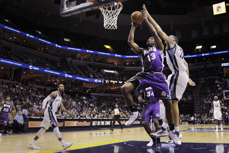 Sacramento Kings' Tyreke Evans (13) goes to the basket in front of Memphis Grizzlies' Tayshaun Prince during the first half of an NBA basketball game in Memphis, Tenn., Tuesday, Feb. 12, 2013. (AP Photo/Danny Johnston)
