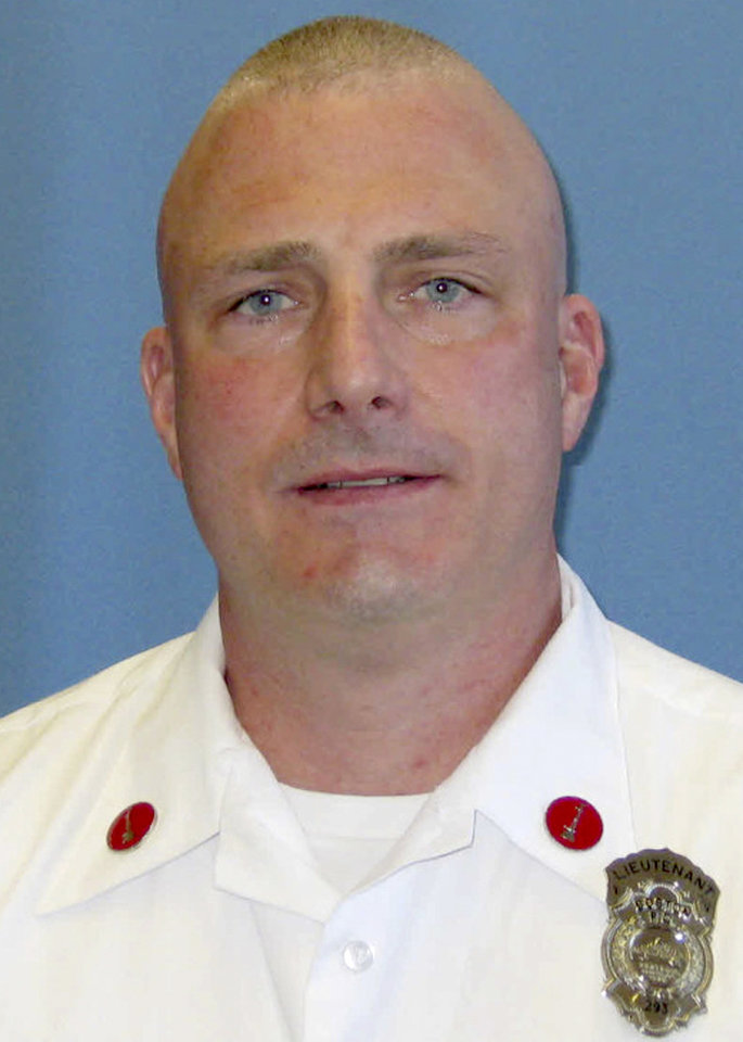 Photo - This undated photo released by the Boston Fire Department via Twitter shows Lt. Edward J. Walsh, killed Wednesday, March 26, 2014, when trapped in the basement while fighting a fire in an apartment building in Boston. Walsh, 43, and a father of three, was assigned to Engine 33, and had been a firefighter for almost a decade. (AP Photo/Boston Fire Department)