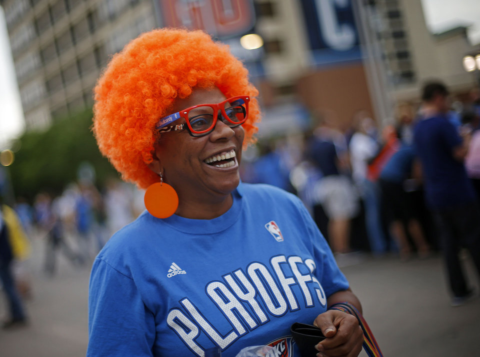 Photo - Veronica Williams of Oklahoma City walks towards the arena before Game 2 of the Western Conference semifinals in the NBA playoffs between the Oklahoma City Thunder and the Los Angeles Clippers at Chesapeake Energy Arena in Oklahoma City, Wednesday, May 7, 2014. Photo by Bryan Terry, The Oklahoman