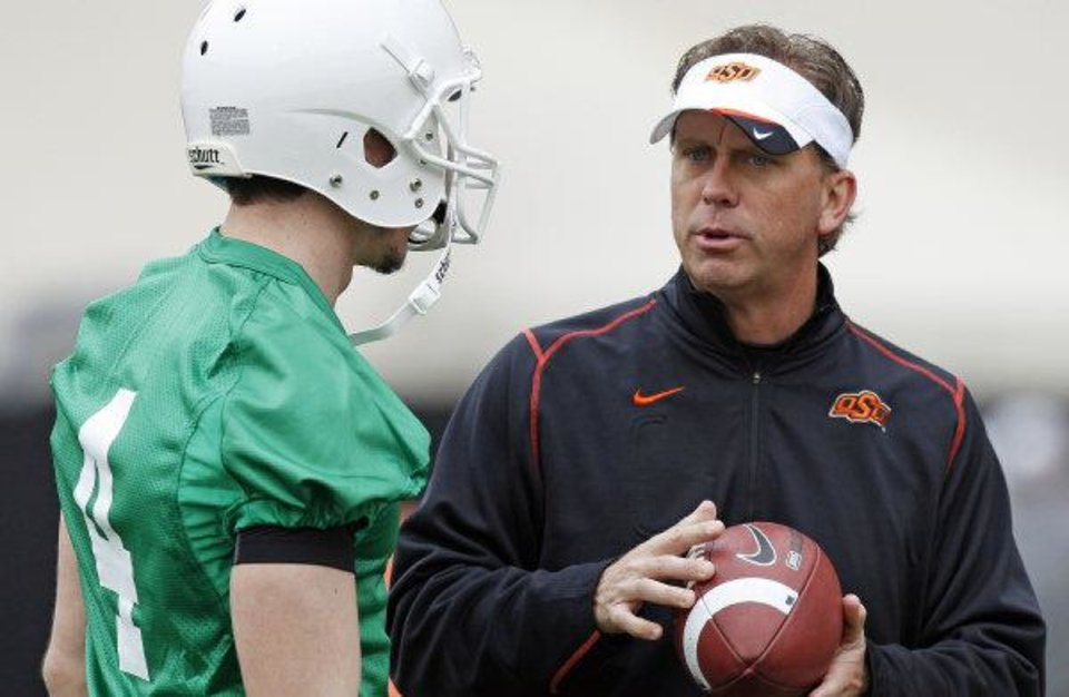 Photo - Oklahoma State offensive coordinator Todd Monken told The Oklahoman he has not interviewed to be the next head coach at Illinois, contrary to multiple reports. PHOTO BY NATE BILLINGS, The Oklahoman Archive  NATE BILLINGS