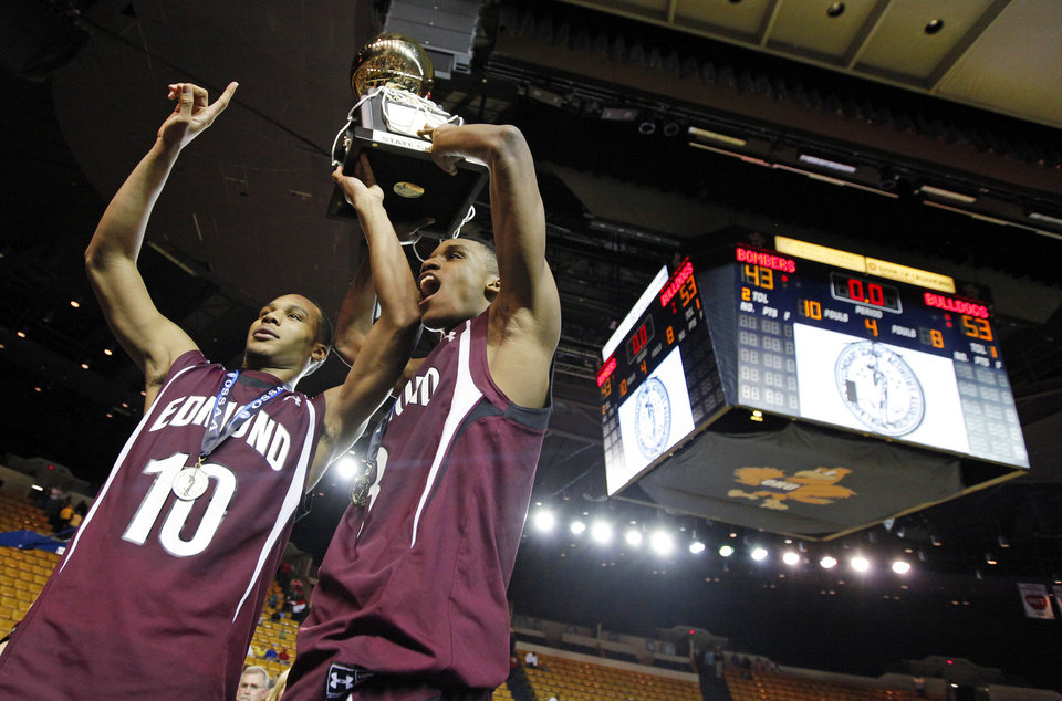 Edmond Memorial\'s Jordan Woodard (10) and James Woodard (3) celebrate with the gold ball trophy after the Class 6A boys basketball state championship game between Midwest City and Edmond Memorial at the Mabee Center in Tulsa, Okla., Saturday, March 12, 2011. Edmond Memorial won, 53-43. Photo by Nate Billings, The Oklahoman