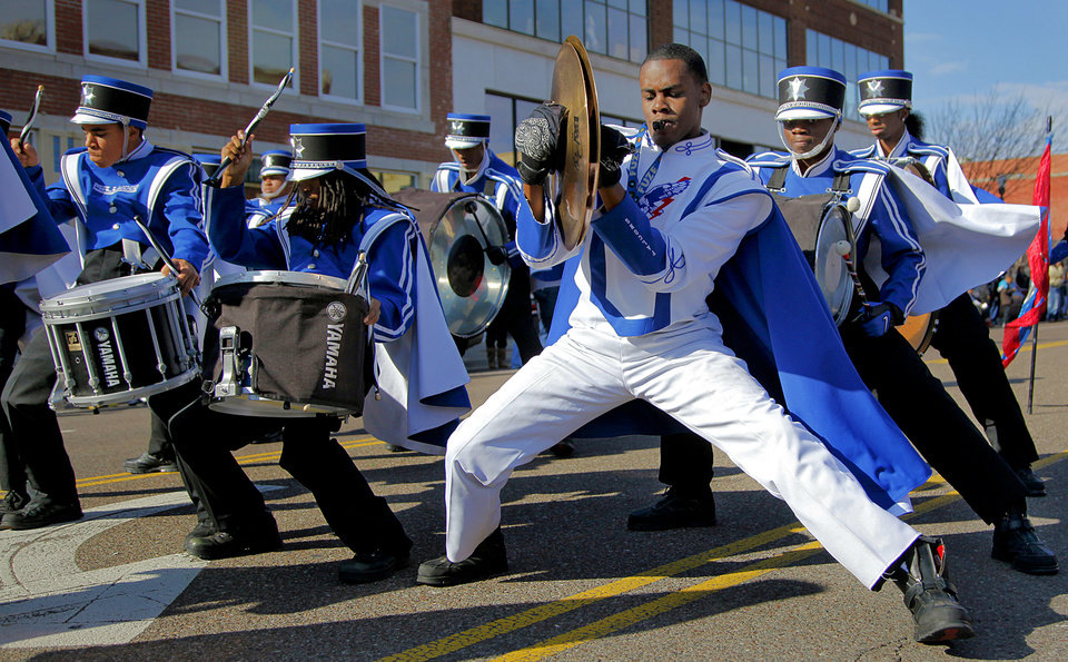 Photo - The Millwood Marching Band performs during the Martin Luther King Jr. parade in downtown on Monday, Jan. 17, 2011, in Oklahoma City, Okla. .  