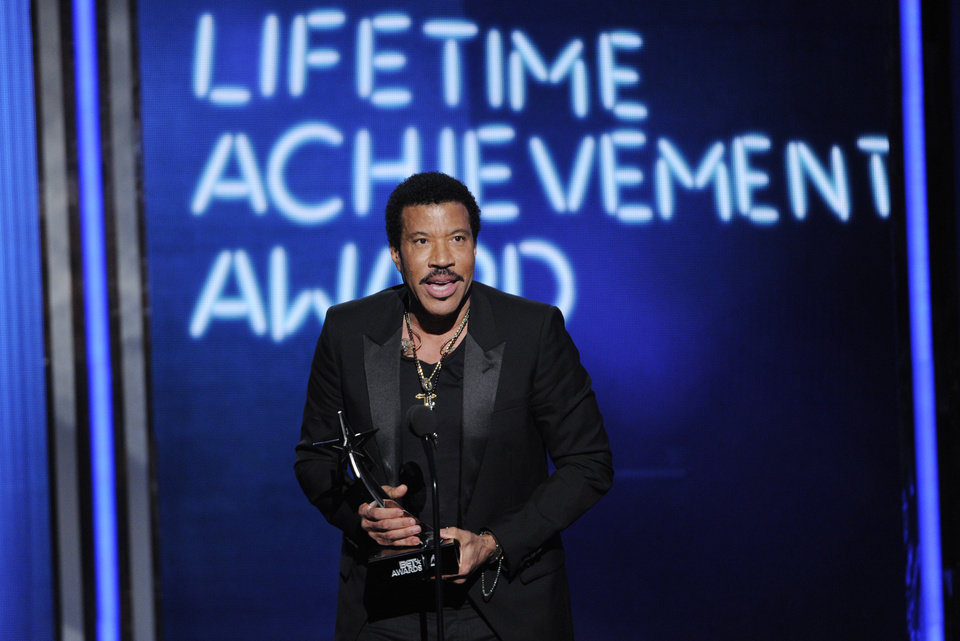 Photo - Lionel Richie accepts the lifetime achievement award at the BET Awards at the Nokia Theatre on Sunday, June 29, 2014, in Los Angeles. (Photo by Chris Pizzello/Invision/AP)