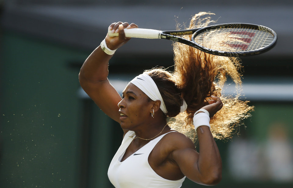 Photo - Serena Williams of U.S. plays a return to Anna Tatishvili of U.S. during their match at the All England Lawn Tennis Championships in Wimbledon, London, Tuesday, June 24, 2014. (AP Photo/Sang Tan)